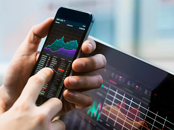 Trading on phone and laptop